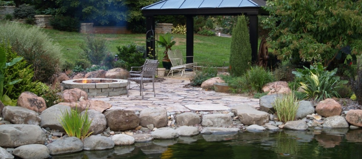 rock firepit and water feature